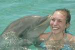 Mandy Block, accident victim of the July 9th 2003 Sausage Race at baseball stadium Miller Park which is called home by the Major League Baseball Team the Milwaukee Brewers, receives kiss from a bottlenose dolphin on March 18 2004 during the dolphin swim program at Curacao Dolphin Academy while vacationing in Curacao, the homeland of Pittsburgh Pirates first baseman Randall Simon, as a special guest of the island's Tourist Buro.