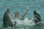 Mandy Block, accident victim of the July 9th 2003 Sausage Race at Milwaukee Brewers home baseball stadium Miller Park, plays with bottlenose dolphins on March 18 2004 during the dolphin swim program at Curacao Dolphin Academy while vacationing in Curacao as a special guest of the island's Tourist Buro.