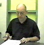 Dr. Dan Burisch Reading a Document