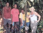 Playa de Oro staff with Tracy Wilson by camera trap