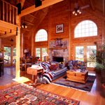 The owners of this home by Northeastern Log Homes selected a Western theme for their interior. The cathedral ceiling and generous windows give this modest log home — under 2,000 square feet — a spacious feeling.
