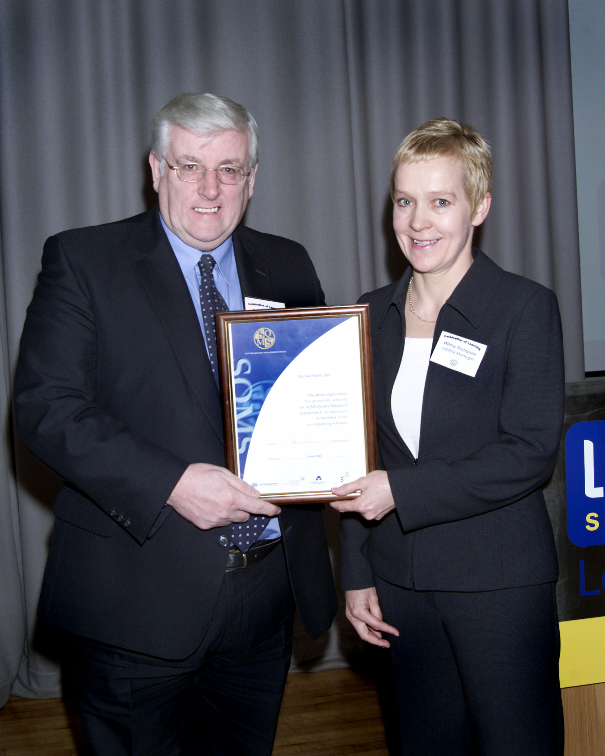 Learndirect Scotland chief executive Frank Pignatelli presents the SQMS award to Access North Ayr Job Link manager Wilma Thompson.