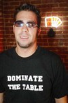 "All N Poker CEO Will Hunt wearing signature ""Dominate the Table"" t-shirt"
