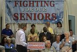 John Kerry listens to seniors talk about rising health care and prescription drug costs during a visit to St. Ann's Inter-generational Care Facility in Milwaukee.