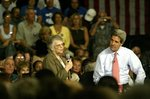 Betty Dizik of Tamarac, Fla. speaks about her high prescription drug costs as John Kerry listens during a town hall meeting on protecting Social Security and strengthening Medicare.