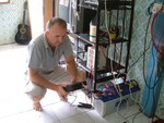 Here, a Battery Doctor goes through the last phrase of reconditioning as he tests the now ready battery for use.