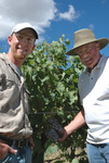 Ciel du Cheval Vineyard manager Ryan Johnson (l) and owner Jim Holmes (r) proudly display part of America's frist commercial crop of certified Brunello Clone sangiovese grapes in Washington's Red Mountain AVA.
