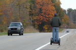 Josh Caldwell travels on Highway 12 in Indiana. He's the first person to cross the country on a Segway HT.