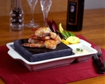 """Seafood is even more delightful when cooked on Hot Rock's volcanic rocks."""