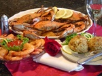 Harbour House Maryland Blue Crabs complete with jumbo gulf shrimp and crab cakes.