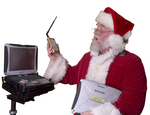 An image of Santa Claus admiring his new technology