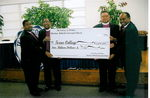 Bishops Lawrence L. Reddick, III, Paul A.G. Stewart, Marshall Gilmore and Henry M. Williamson, Sr. display the check given to Texas College by the Christian Methodist Episcopal Church.