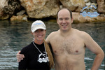 Low Resolution photo of Prince Albert of Monaco with dolphin trainer Aimee Brown of Curacao Dolphin Academy.