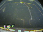 An image captured by the VideoRay of the submerged vehicle's windshield.