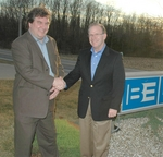 Left to right: Allen Hartle, The Radio Experience, and Broadcast Electronics President John Pedlow finalize a merger of datacasting technologies to benefit broadcast text services.