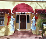 Venus & Zeus Welcome You at the Entrance to Villa Sinclair Beach Suites & Spa