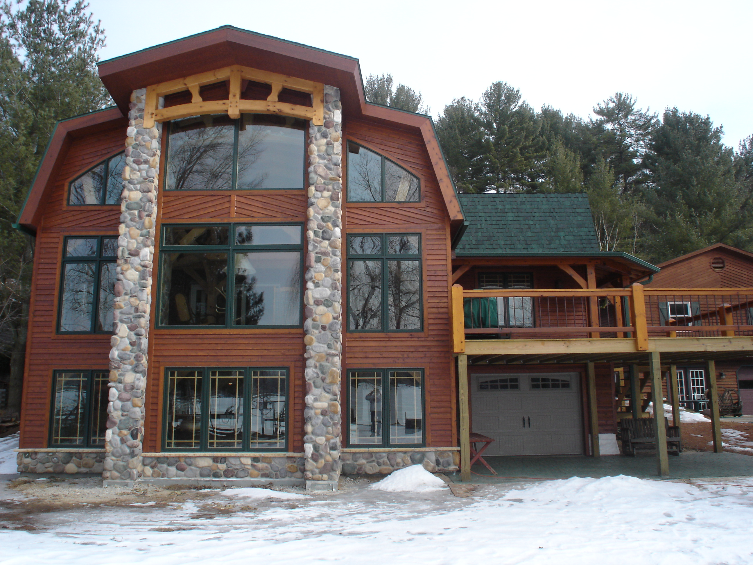 North woods timber frames builder of handcrafted timber for Beautiful a frame homes