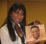 Natalie Cole is holding a Nat King Cole Carry-a-Tune purse that was made especially for her. All other recipients received a gift certificate so they can choose a purse made especially for them.