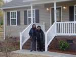 Ava and Easter Butler outside a new home in Smitherman Village in Troy, NC.
