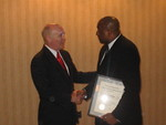 Andrews accepts congratulations from DC Bar President