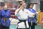 Instructor Andrea Collins teaches a technique at the Women's Self-Defense Seminar
