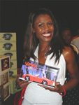 Omarosa, from the Apprentice, with 1994 Dodge Viper Phone