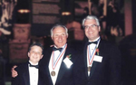 Thomas Stankovich with a medalist friend and his son