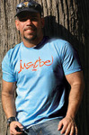"""""""Marcio Pereira, owner of Just Be NYC, models one of his T-shirt creations."""""""
