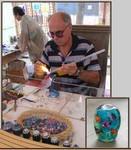 Luigi Cattelan making a glass bead on the torch