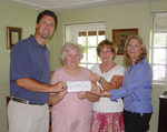 Janet Russell Nixon (second from left) accepts the ACFA donation from (left to right) Fred Rewey, Cathy Simmons, ACFA business manager, and Tracy Z. Rewey.