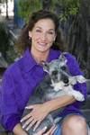 Sondra Raines, president of Oscart, shown here with her artist dog, Oscar the Schnauzer.