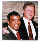 CyberLearning Chairman Dr. Appu Kuttan with Former President Bill Clinton