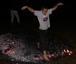 Boy walking across fire