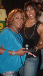 Morgan Robinson, YB Marketing Dir., (right) presents YB Timepiece to Patti LaBelle at WMA