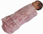 Sleeping baby swaddled in Miracle Blanket-special edition camo