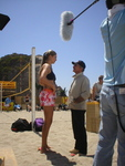 Burt Reynolds stands in a hole to get a bigger laugh from a scene with volleyball sex symbol Gabrielle Reece in a scene from 'Cloud 9,' the motion picture written and produced by Brett Hudson, Burt Kearns & Albert S. Ruddy, released with Frozen Pictures extras January 3 on a Fox Home Entertainment DVD. (Frozen Pictures)