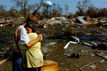 A New Orleans couple in front of their home lost in Hurricane Katrina.