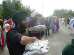 Sikhs distribute free food in the spirit of Seva