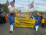 Saint Soldiers March in front of the float carrying the Guru Granth Sahib