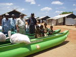 Fisher families in Trincomalee, Sri Lanka, receive canoes and nets from Rotary clubs