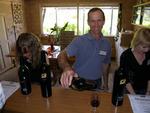 Drew Noon pouring his wine at cellar door