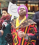 Hon. Queen Mother Dr. Delois Blakely, Community Mayor of Harlem, pouring libartions at boycott press conference in New York City.  photo by Donna Lamb