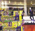 """Piano Wizard Video Game Packages on Display in Front of the """"Big"""" Keyboard Dancers at FAO Schwarz"""