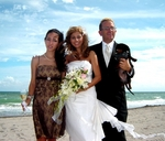 The newlyweds pose with their friend, Jade, and their dog, Valentino.