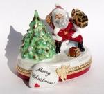 Santa by Christmas Tree