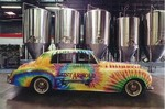 The label for Saint Arnold Summer Pils features a tye-die design, similar to the brewery's 1957 Bentley.