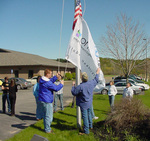 Oneupweb teammates raise the flags at their headquarters.  Oneupweb plans to add 12,000 square feet to its current space in spring of 2006.