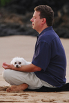 James Jacobson meditating on the beach in Maui.