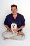 James Jacobson with his maltese Maui.