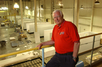 Ice House President Bob Alligood poses above the assembly floor of the manufacturing plant in Moultrie, GA.